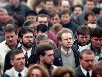 Martin McGuinness and Gerry Adams join mourners at the funeral of IRA man Thomas Begley in Belfast