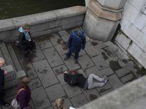 A man lies injured on Westminster Bridge