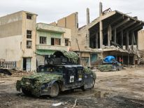 An armoured vehicle of the Iraqi counter-terrorism service (CTS) advances in al-Dawasah neighbourhood in west Mosul