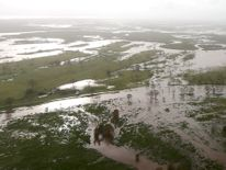Flooded areas can be seen from an Australian Army helicopter