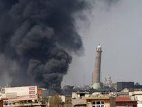 Smoke rises from clashes near Mosul's Al-Habda minaret at the Grand Mosque in Mosul