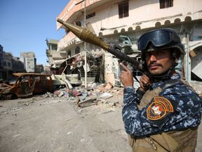 A member of the Iraqi forces stands guard at the frontline of the Old City of Mosul on March 25, 2017, during the government forces' ongoing offensive to retake the city from Islamic State (IS) group fighters