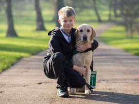 Joel Sawyer with Caddie who was given to him by the charity Dogs for Good