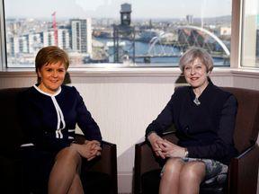 Nicola Sturgeon (L) and Theresa May
