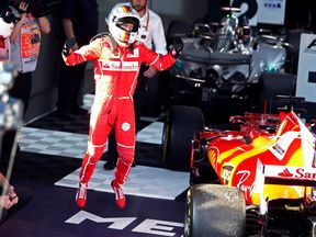 Ferrari driver Sebastian Vettel of Germany celebrates after winning the Australian Grand Prix