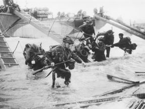 Troops from the 48th Royal Marines at Saint-Aubin-sur-mer on Juno Beach, Normandy, on 6 June, 1944