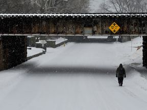 A man walks through the snow after Storm Stella hit Greenwich, Connecticut