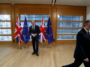 Tim Barrow leaves after he delivered Minister Theresa May's Brexit letter to EU Council President Donald Tusk in Brussels