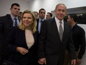 Israeli Prime Minister Benjamin Netanyahu (R) and his wife Sara arrive at a courtroom to testify in a libel lawsuit they filed against an Israeli journalist, at the Magistrate Court in Tel Aviv, Israel March 14, 2017