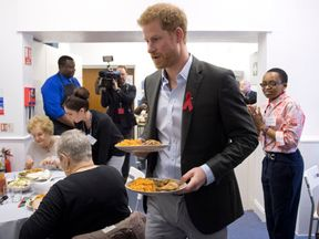 Prince Harry helps serve food at a centre for people with issues surrounding HIV in Leicester