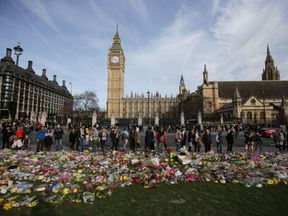Floral tributes to the victims of the March 22 terror attack are seen in Parliament Square in central London on March 26, 2017. British police investigating the terror attack on parliament made a new arrest on March 26 as authorities try to piece together the assailant's motive. / AFP PHOTO / Daniel LEAL-OLIVAS (Photo credit should read DANIEL LEAL-OLIVAS/AFP/Getty Images)