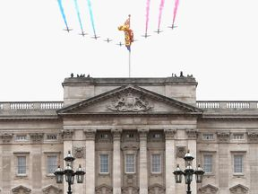The Red Arrows fly over Buckingham Palace in 2015