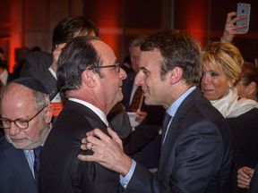 Francois Hollande greets Emmanuel Macron at a dinner in Paris in February