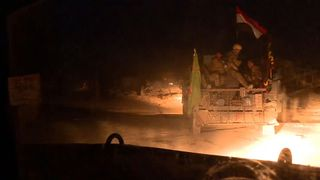 Sky's Stuart Ramsay went out on a rare night-time raid with Iraqi forces