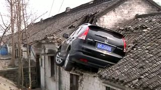 A car swerved and ended up on a roof in China