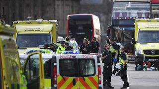 Police and ambulance crews at the scene in Westminster, London, following a terror attack in which several people have been killed and many more injured