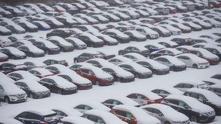 Vehicles in a car park in Norristown, Pennsylvania, are covered in snow