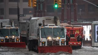 Snow plows go through New York City as Storm Stella brought blizzard conditions to the US East Coast