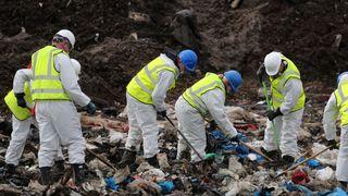Police search a landfill site in Milton, Cambridgeshire