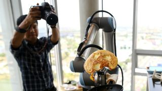 A robot performs making an omelette during an exhibition at the CP All Acadamy in Bangkok, Thailand