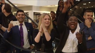 John Lewis staff cheer their bonus award in 2016