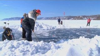 Golfers playing a tournament on the frozen Lake Baikal