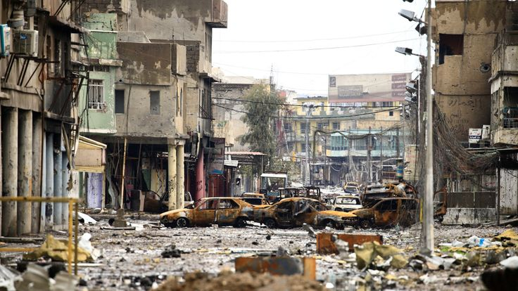 Cars burnt and destroyed by clashes on a street during a battle between Iraqi forces and Islamic State militants, in Mosul