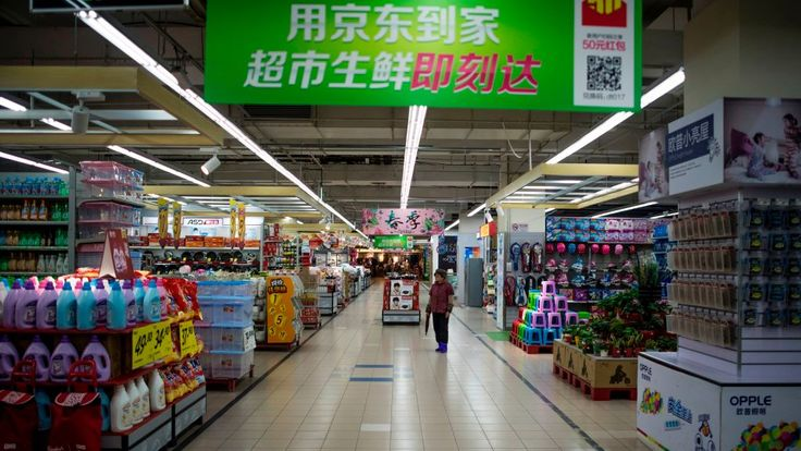 A woman stands in an almost empty Lotte Mart in Shanghai