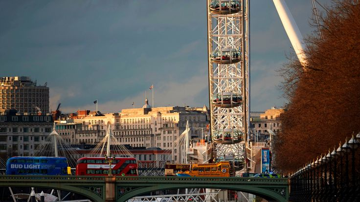 People are seen inside the pods of the London Eye, central London, as emergency services deal with the aftermath of a terror incident at Parliament