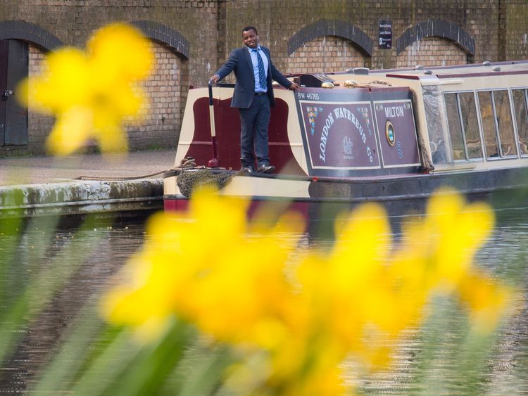A man enjoys the sunshine aboard a narrowboat in Little Venice, London, on a day when temperatures in the south east of England were expected to be higher than the seasonal average and reach 22C