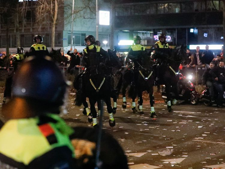 Riot police use horses to remove demonstrators outside the Turkish consulate in Rotterdam, Netherlands March 12, 2017. REUTERS/Yves Herman