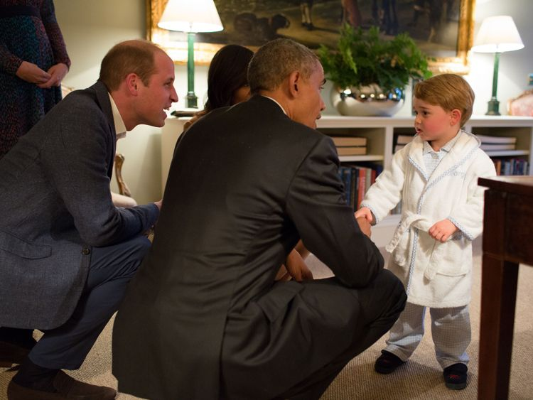 Prince George meeting the President of the United States Barack Obama (centre) and First Lady Michelle Obama (behind) at Kensington Palace, in April 2016