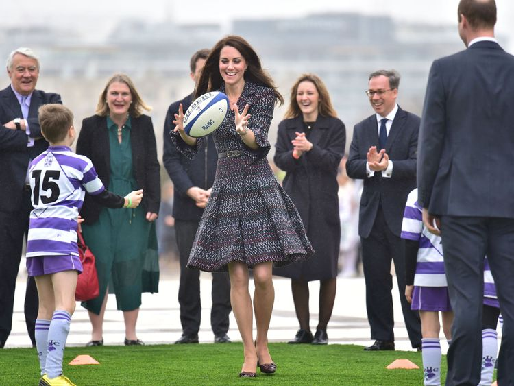The Duke and Duchess of Cambridge at the Trocadero, join in a game of rugby with school children