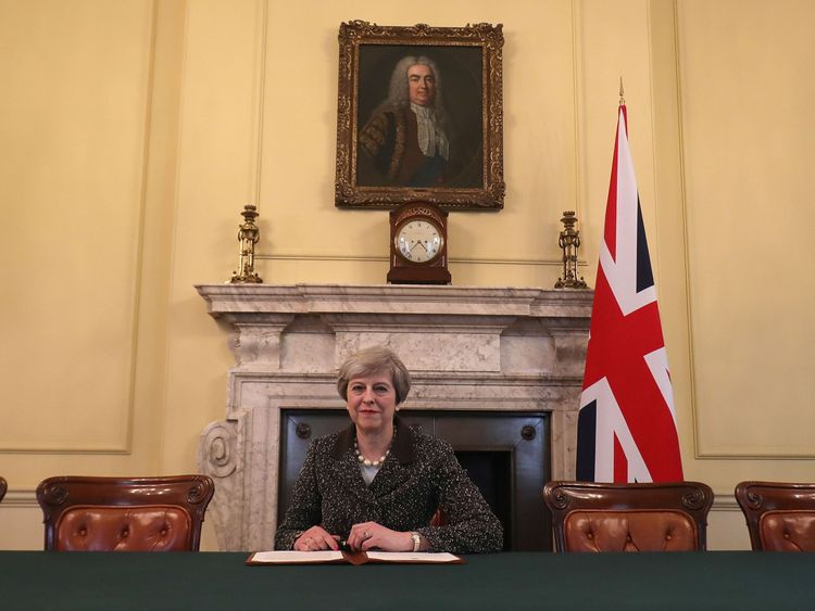 Embargoed to 2200 Tuesday March 28 Prime Minister Theresa May in the cabinet signs the Article 50 letter, as she prepares to trigger the start of the UK's formal withdrawal from the EU on Wednesday