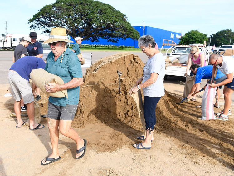 Townsville residents fill sandbags in preparation for Cyclone Debbie