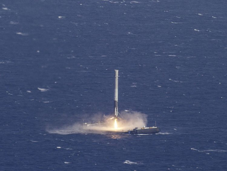 The reusable main-stage booster from the SpaceX Falcon 9 rocket makes a successful landing on a platform in the Atlantic Ocean in April 2016