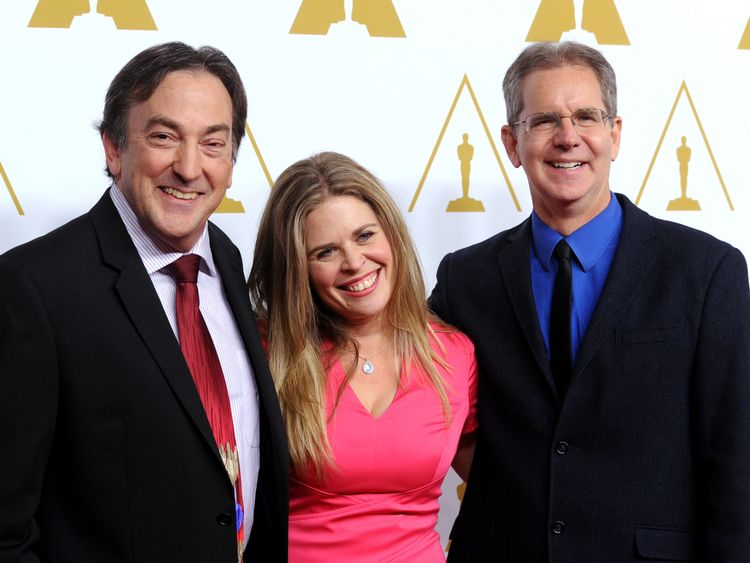 Frozen Producer Peter Del Vecho (L) and directors Jennifer Lee and Chris Buck