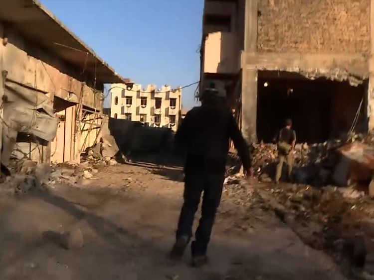 Sky's Stuart Ramsay runs for cover in Mosul