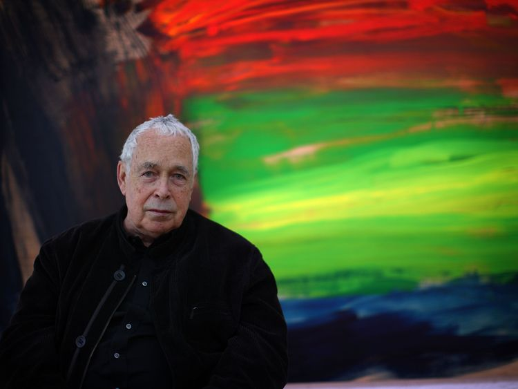 Howard Hodgkin posing next to a detail of his painting Where The Deer And The Antelope Play