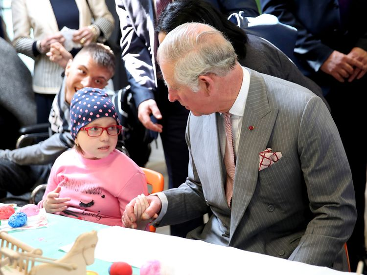 The Prince of Wales meets residents in the Hospice of Hope in the Romania capital