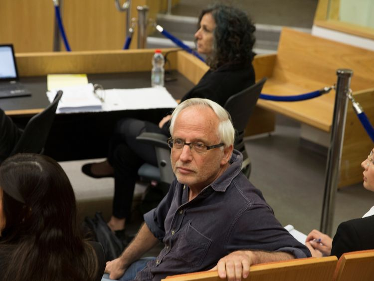 Israeli journalist Yigal Sarna is seen before the arrival of Israeli Prime Minister Benjamin Netanyahu and his wife Sara (not seen) to testify in a libel lawsuit they filed against Sarna, at the Magistrate Court in Tel Aviv, Israel March 14
