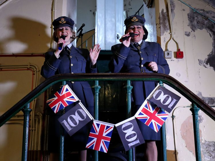 Learna Castle (left) and Annie Riley of Swing Time Sweethearts perform during a tribute to Dame Vera Lynn