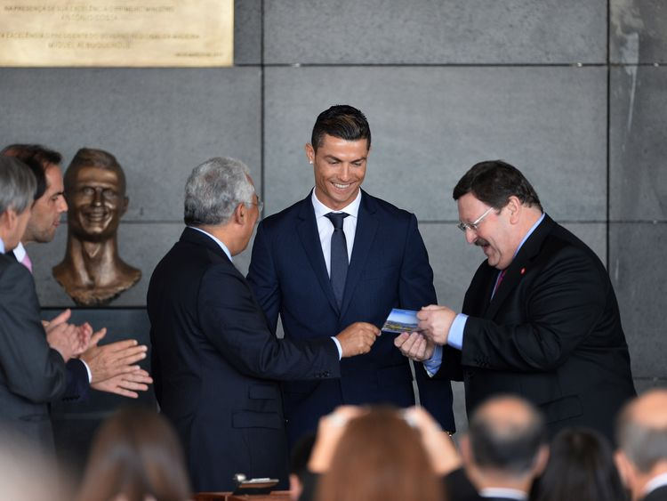 The Real Madrid and Portugal star smiles during the ceremony