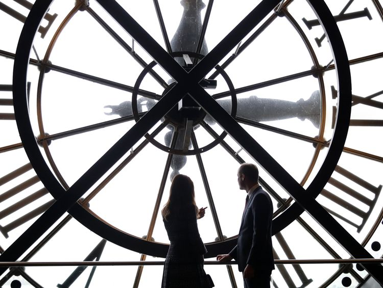 The Duke and Duchess of Cambridge look through the clock at Musee d'Orsay in Paris