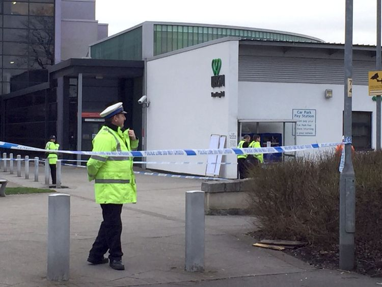 Police at the scene in a car park at Withington Community Hospital