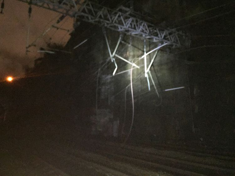 Overhead cables were also damaged by the wall collapse