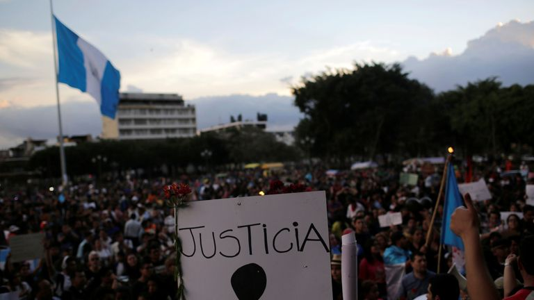 A sign reads 'justice' during the protest in front of the National Palace