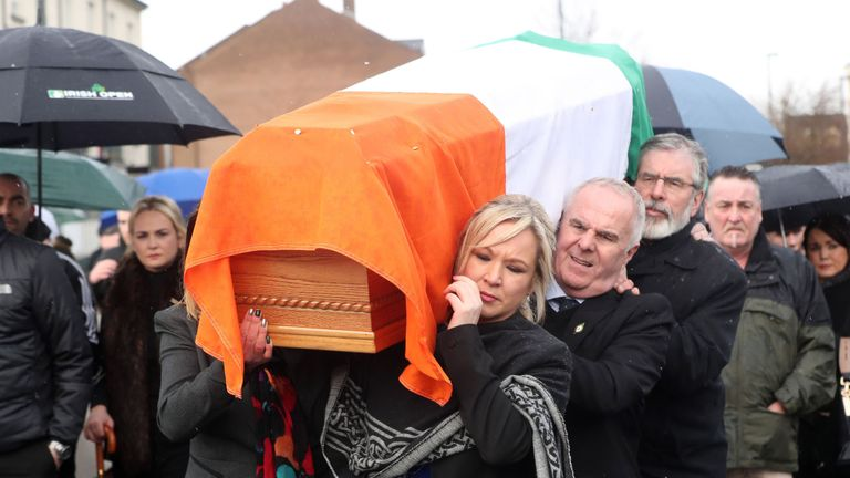 Michelle O'Neill and Gerry Adams carry Martin McGuinness' coffin