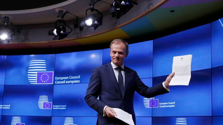 Donald Tusk leaves after receiving Theresa May's Brexit letter in Brussels