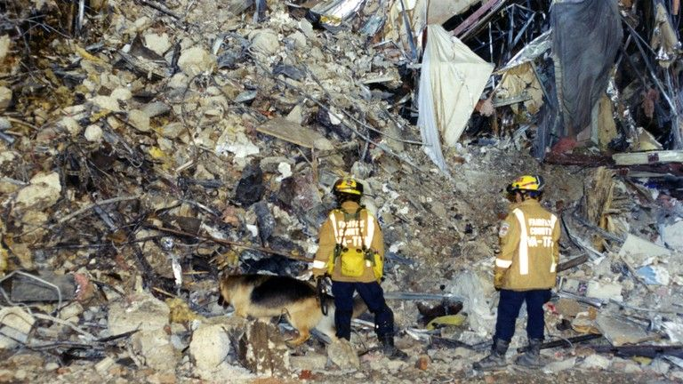 Rescue workers search for survivors at the Pentagon after 9/11
